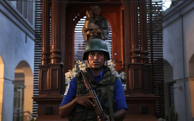 A Sri Lankan soldier stands guard at the damaged St. Anthony's Church in Colombo, Sri Lanka, April 26, 2019.  (AP Photo/Manish Swarup)