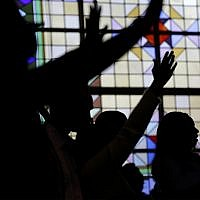 Illustrative: People worship at Grace Baptist Church in Mt. Vernon, New York, April 17, 2016. (AP Photo/Seth Wenig)