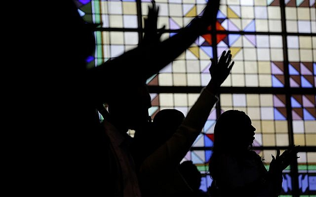 People worship at Grace Baptist Church in Mt. Vernon, New York, April 17, 2016. (AP Photo/Seth Wenig)