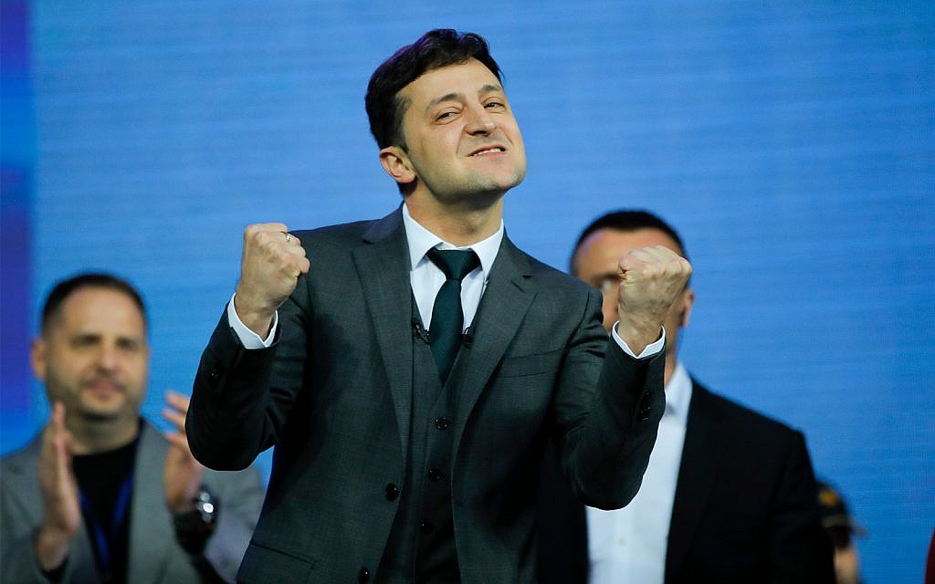 Volodymyr Zelensky, Ukrainian actor and candidate reacts after debates between in the weekend presidential run-off at the Olympic stadium in Kiev, Ukraine, April 19, 2019. (AP Photo/Vadim Ghirda)