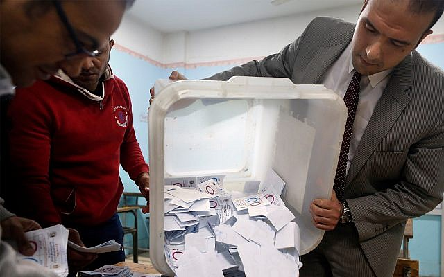 Election workers count ballots at the end of three-day vote on constitutional amendments at a polling station in Cairo, Egypt, April 22, 2019. (AP Photo/Amr Nabil)