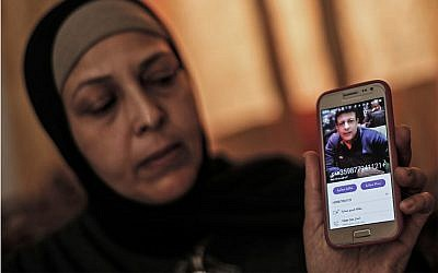 The sister of Zaki Mubarak shows his picture during an interview in their family home in Deir al-Balah, in central Gaza Strip on April 30, 2019. (Mahmud Hams/AFP)