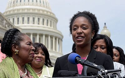 American University student government president Taylor Dumpson, right, accompanied by Rep. Sheila Jackson Lee, D-Texas, left, and others, speaks during a news conference on Capitol Hill in Washington, Thursday, May 4, 2017. (AP Photo/Susan Walsh)