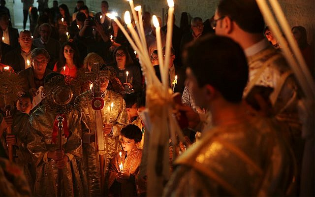 Orthodox Christian worshipers at an Easter service at the St. Porphyrios church in Gaza City, April 15, 2017. (AP Photo/Adel Hana)
