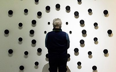 A vistor stands in front of a sound installation in one of the exhibition halls during the press preview prior to the opening of the new Bauhaus Museum of the 'Klassik Stiftung Weimar' (Classic Foundation Weimar) in Weimar, Germany, April 4, 2019. (AP Photo/Jens Meyer)