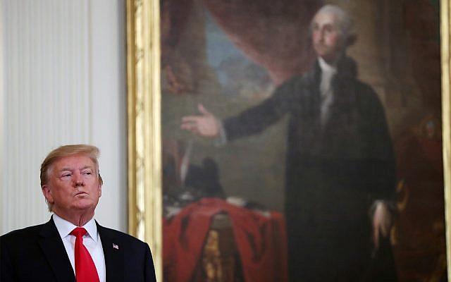 President Donald Trump stands near a portrait of George Washington at an event at the White House, April 18, 2019. (AP Photo/Andrew Harnik)
