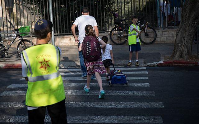 Illustrative: children on their way to school in Jerusalem, September 2, 2018. (Hadas Parush/Flash90)
