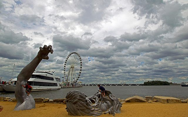 Illustrative: Children play on a sculpture at National Harbor, Maryland, September 3, 2016. The site was targeted in an IS-inspired terror attack by 28-year-old Rondell Henry, federal prosecutors said on April 8, 2019. (AP Photo/Jose Luis Magana, File)
