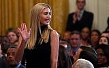 Ivanka Trump, assistant to the president, stands up as she is recognized by US President Donald Trump at the 2019 Prison Reform Summit and First Step Act Celebration in the East Room of the White House in Washington, April 1, 2019. (AP Photo/Susan Walsh)