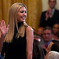 Ivanka Trump, assistant to the president, stands up as she is recognized by President Donald Trump at the 2019 Prison Reform Summit and First Step Act Celebration in the East Room of the White House in Washington, April 1, 2019. (AP Photo/Susan Walsh)