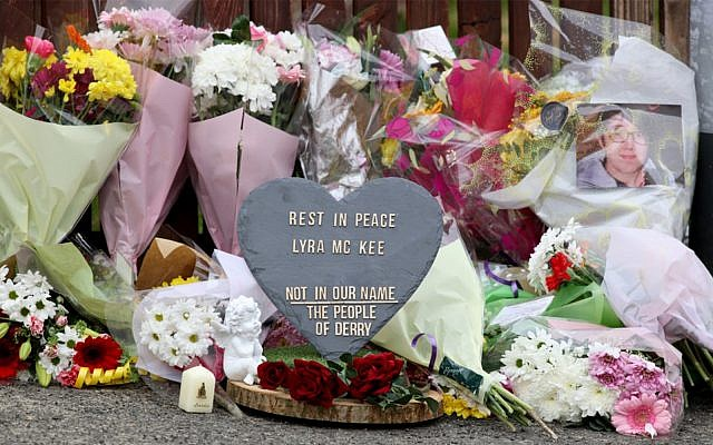 Floral tributes and a plaque condemning the killing of journalist Lyra McKee are seen at the scene of the overnight violence in the Creggan area of Derry/Londonderry in Northern Ireland, April 19, 2019. (Paul Faith/AFP)