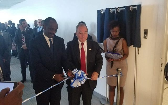Rwandan Foreign Minister Richard Sezibera, left, and the director-general of Israel's Foreign Ministry Yuval Rotem open Israel's new embassy in Kigali, Rwanda, April 1, 2019 (courtesy MFA)