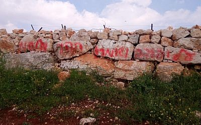 Grafitti at the site of a suspected anti-Arab hate crime in the West Bank village of Deir Jarir on April 3, 2019 (Courtesy of Israel Police)