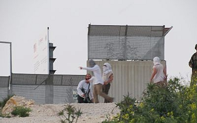A photo released by B'Tselem on April 13, 2019, shows Israelis during clashes in the northern West Bank village of Urif. (Adel Ammar/B'Tselem)