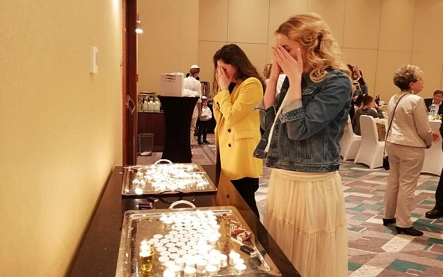 Attendees gather to light the holiday candles ahead of sunset at the Warsaw Hilton, April 19, 2019. (Courtesy Chabad of Warsaw)