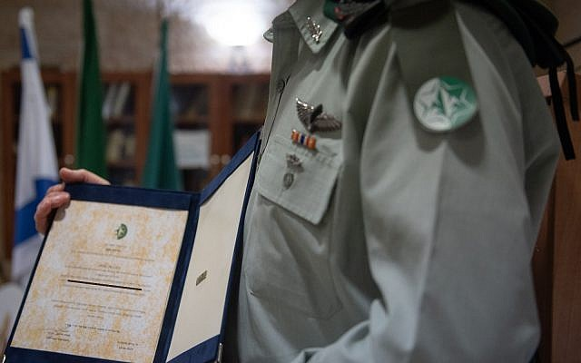 The commander of Unit 504 receives an official commendation in April 2019. For security reasons, the commander's identity is classified. (Israel Defense Forces)