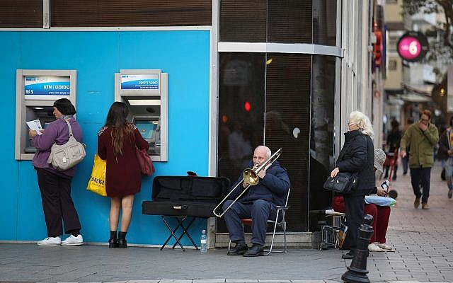 Illustrative image: Withdrawing money at Bank Leumi on Dizengoff Street, Tel Aviv, January 18, 2015. (Nati Shohat/Flash90)