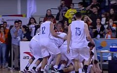 Players from Tel Aviv's Tichon Hadash high school basketball team celebrating after winning the world championship on April 19, 2019. (Screen capture: YouTube)