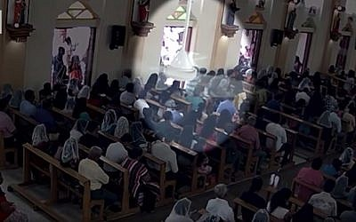 Security camera footage shows a suicide bomber, carrying a backpack, entering a church in Negombo, Sri Lanka on April 21, 2019 (screen capture: CNN)