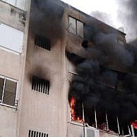 Fire burns in apartment block in Haifa, April 15 2019 (Haifa Fire Rescue Services)