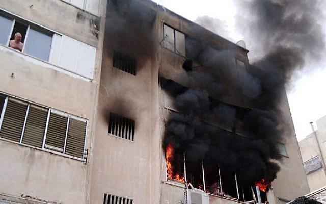 Fire burns in apartment block in Haifa, April 15 2019 (Haifa Fire Rescue Services)