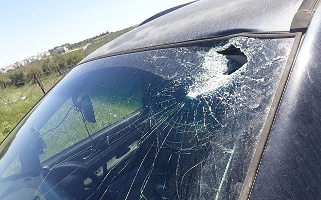 Israeli car damaged by a hammerhead, April 10, 2019, near the West Bank settlement of Tekoa. (Rescuers Without Borders)