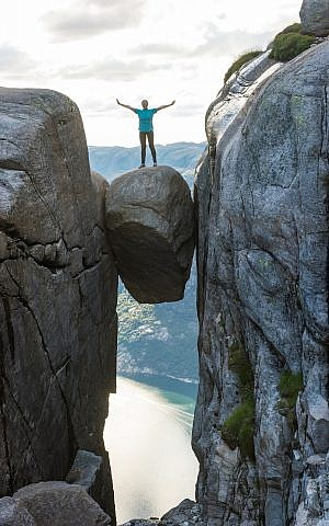 Illustrative: A woman on the Kjeragbolten mountain boulder in Norway. (iStock photos/kotangens)
