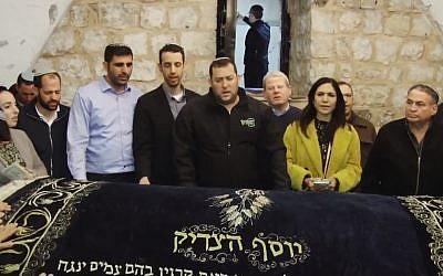 Incoming Knesset members pray at Joseph's Tomb near Nablus, West Bank Samaria Regional Council head Yossi Dagan (C) Likud's Eti Atia (3rd R) Likud's Uzi Dayan (R) Likud's Ariel Kallner (5th L), Union of Right-Wing Parties incoming MK Idit Silman, on April 24, 2019 (Screen grab via Twitter)