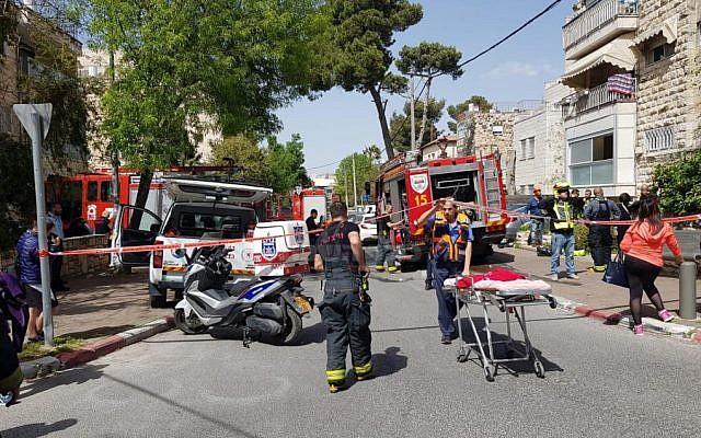 Firefighters and paramedics at the scene of the house fire, Arnona, Jerusalem, April 8, 2019. (ZAKA)