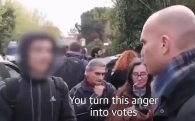 An Italian teen (L) confronts a far-right protester in the Rome suburb of Torre Maura in a video that went viral, on April 2, 2019 (screenshot)