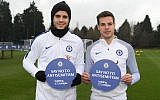 Alvaro Morata, left, and Cesar Azpilicueta of Chelsea back the Say No To Antisemitism campaign at Chelsea Training Ground in Cobham, England on January 12, 2018. (Darren Walsh/Chelsea FC via JTA)