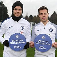 Alvaro Morata, left, and Cesar Azpilicueta of Chelsea back the Say No To Antisemitism campaign at Chelsea Training Ground in Cobham, England on January 12, 2018. (Darren Walsh/Chelsea FC via JTA)