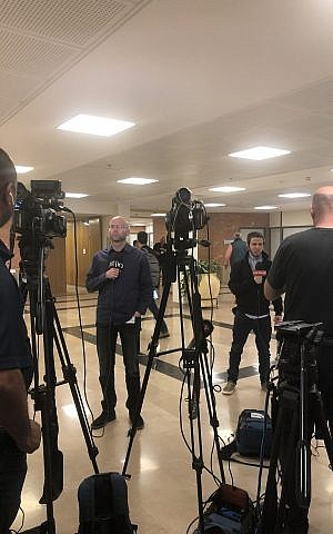 TV reporters having to give updates on the hour outside the Central Elections Committee room at the Knesset, April 11 2019. (Sue Surkes/Times of Israel)