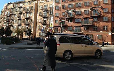A US ultra-Orthodox man crosses the street in Williamsburg, Brooklyn, New York. (Gil Shefler via JTA)