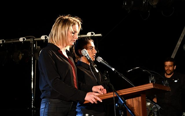 Mika Almog and Samira Saraya, the service's emcees, speaking to a joint Israeli-Palestinian Memorial Day service on May 7, 2019. (Rami Ben-Ari/Combatants for Peace)