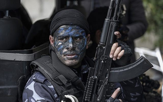 A Palestinian Hamas police cadet takes part in a graduation ceremony at the Arafat City police headquarters in Gaza City, on April 20, 2019. (Mahmud Hams/AFP)