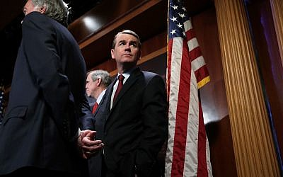 In this file photo taken on March 27, 2019, US Senator Michael Bennet listens during a news conference on climate change at the US Capitol in Washington, DC. (ALEX WONG / GETTY IMAGES NORTH AMERICA / AFP)