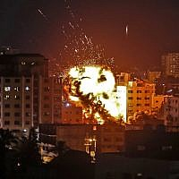An explosion is seen among buildings during an Israeli airstrike on Gaza City in response to rocket fire from the Palestinian enclave on May 4, 2019. (Mahmud Hams/AFP)