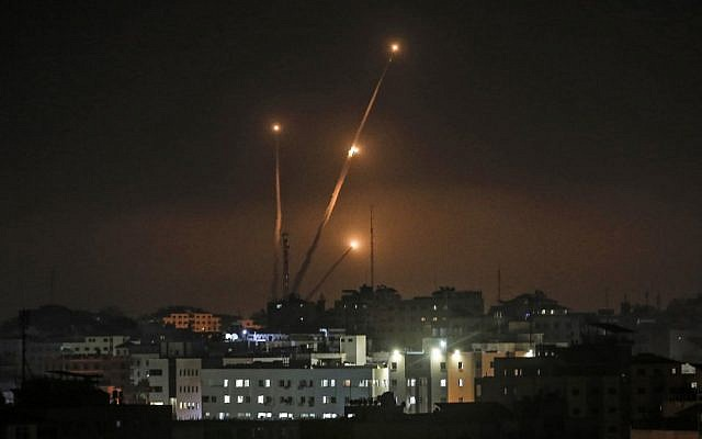 Illustrative: A picture taken in Gaza city on May 5, 2019, shows rockets fired toward Israel from the Gaza Strip. (Mahmud Hams/AFP)