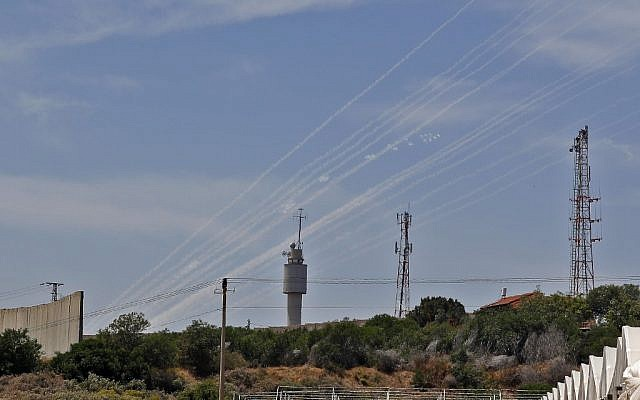 The smoke trails of rockets fired at Israel from the Gaza Strip, seen from the southern Israeli village of Netiv Haasara on May 5, 2019. (Jack Guez/AFP)
