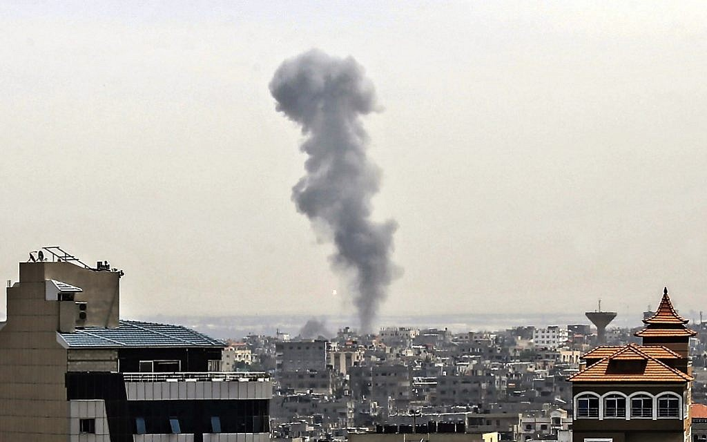 Smoke billows above buildings in Rafah in the southern Gaza Strip during an Israeli airstrike on the Palestinian coastal enclave, on May 5, 2019. (Said KHATIB / AFP)
