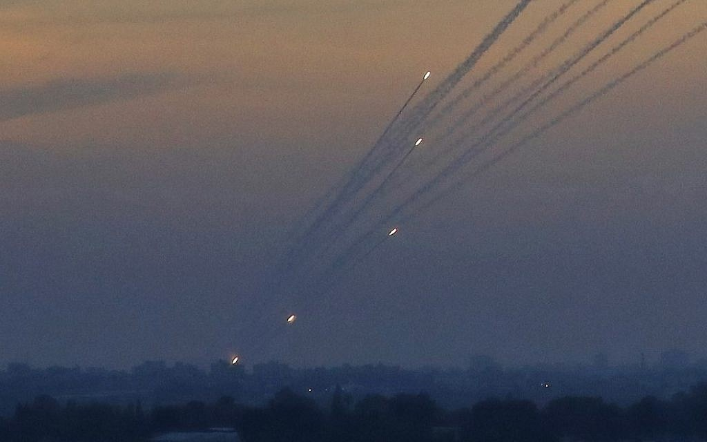 Illustrative: A picture taken on May 5, 2019 from the Israel-Gaza border shows a barrage of rockets being fired from the Hamas-run Palestinian enclave. (Jack Guez/AFP)