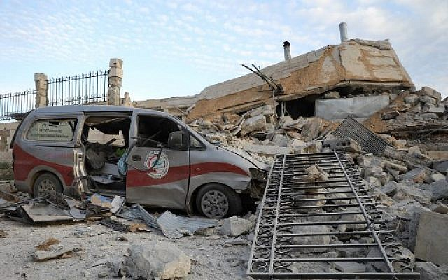 Destruction at the entrance of a hospital in the village of Kafr Nabl, south of the jihadist-held Syrian province of Idlib, May 5, 2019, reportedly hit by Russian airstrikes. (OMAR HAJ KADOUR / AFP)