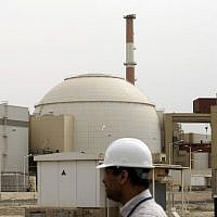 In this file photo taken on February 25, 2009, Iranian technicians walk outside the building housing the reactor of the Bushehr nuclear power plant, in the Iranian port town of Bushehr, 1,200 kilometers south of Tehran. (Behrouz Mehri/AFP Files/AFP)