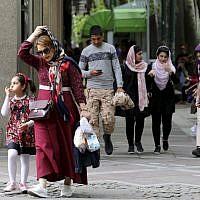 Iranians walk along Valiasr Street in northern Tehran on May 8, 2019. (Atta Kenare/AFP)