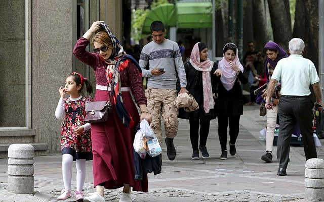 Iranians walk along Valiasr Street in northern Tehran on May 8, 2019. (Atta Kenare/AFP)