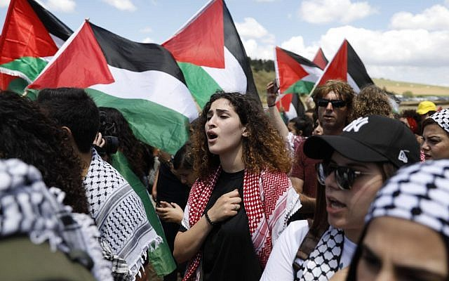 "Arab Israelis wave Palestinian flags as they take part in the annual ""March of Return"" held on Israel's Independence Day, near the northern city of Umm al-Fahm, on May 9, 2019. (Ahmad Gharabli/AFP)"
