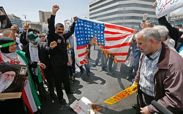 Iranian demonstrators burn a makeshift US flag during a rally in the capital Tehran, on May 10 2019. (Stringer/AFP)