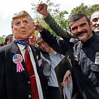 Iranian demonstrators carry a portrait of Iran's Supreme Leader Ayatollah Ali Khamenei and an effigy of US President Donald Trump during a rally in the capital Tehran, on May 10 2019. (Stringer/AFP)