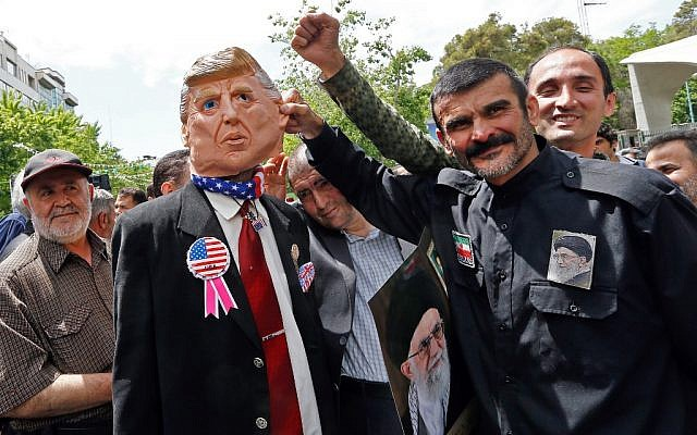 Iranian demonstrators carry a portrait of Iran's Supreme Leader Ayatollah Ali Khamenei and an effigy of US President Donald Trump during a rally in the capital Tehran, on May 10, 2019. (Stringer/AFP)